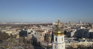 A bird`s eye view, panoramic video from the drone in 4K to the golden dome Saint Sophia`s Cathedral, Maidan. Aerial panoramic video from the drone, bird`s eye stock video