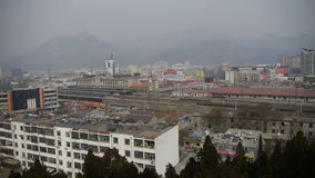 Bird's eye view of railway station of Tai'an city in China.Taishan Mountain. Gh2_01018 stock video footage