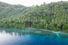 Aerial of Tropical Island Shoreline in Papua New Guinea. A bird`s eye view of the remote island of New Ireland in Papua New Guinea shows a beautiful reef and stock photography