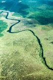 Bird`s-eye view of the river and jungle, taken from the plane. South America royalty free stock photo