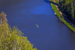 Bird's eye view of a river with people in a canoe. Bird's eye view of the river Saar with people in a canoe stock photography