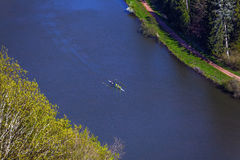 Bird's eye view of a river with people in a canoe. Bird's eye view of the river Saar with people in a canoe stock photos