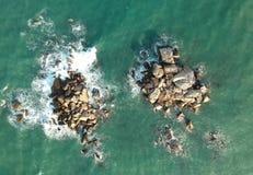 Bird's Eye View of Rocks In Ocean royalty free stock image