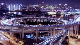 Bird's eye view of shanghai traffic at night,urban cityscape,time lapse. Aerial freeway busy city rush hour heavy traffic jam highway Shanghai at night stock footage