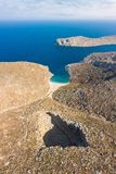 Bird`s eye view of Sikati cave and coast nearby, Kalymnos island, Greece. royalty free stock photo
