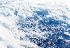 Bird's eye view on snowy mountains stock photography