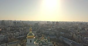 A bird`s eye view video from the drone in 4K to the central bell tower Saint Sophia`s Cathedral in the city Kiev. Pedestal down slow video from the drone, bird`s stock video