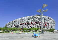 Bird`s Nest Olympic Stadium on a summer day, Beijing. BEIJING-JULY 28. Bird`s Nest on a summer day. The Bird`s Nest is a stadium in Beijing, China, especially Stock Images
