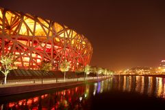 Bird's Nest Stadium. The Beijing National Stadium, also known as The Bird's Nest lit up at night Stock Photo
