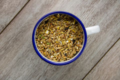 Bird seed in an enamel cup Royalty Free Stock Photography