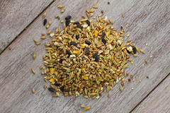 Bird Seed Pile on Wood Stock Photos