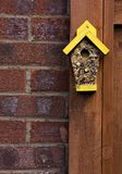 Bird seed in the shape of a house Royalty Free Stock Images