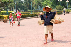 Bird Seller. Birds seller in Pha That Luang, Vientiane, LAOS Stock Photo
