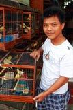 Bird seller Stock Images