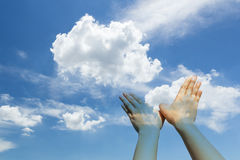 Bird shaped hands on cloud and sky Royalty Free Stock Images
