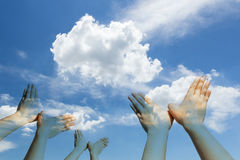 Bird shaped hands on cloud and sky Stock Images