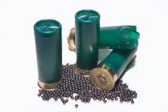 Bird shot. Shotgun cartridges 2 standing up one open with lead shot stock photos