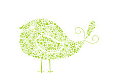 Bird silhouette filled with go green eco signs. On white backdrop - bulb, leaf, globe, drop, apple, house, trash. Ecology concept Stock Photos