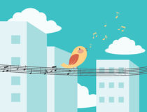 Bird singing in the city Royalty Free Stock Photo
