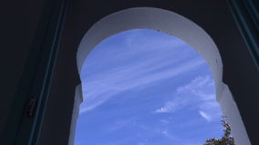 Bird in the sky, view through arched window stock footage
