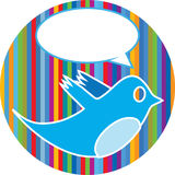Bird with speech bubble. Blue bird with speech bubble on a colorful circular striped background Royalty Free Stock Images