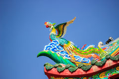 Bird Statue in the Coner Roof. With blue sky royalty free stock images
