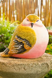 Bird statue in garden Stock Image