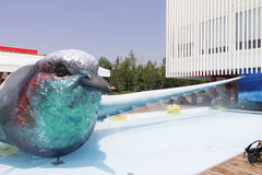 Bird statute, pool and a bar in front of the Czech republics pavilion on Milan EXPO 2015 Royalty Free Stock Photo