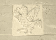 Bird. Tile is made of white clay in the form of magic birds Stock Image