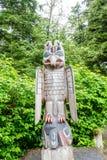 Bird Totem in Alaskan Forest Stock Images