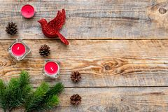Bird toys and candles for new year celebration with fur tree branches on wooden background top veiw mockup Stock Photos