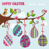 Bird on tree. Easter eggs with ribbons Stock Photo