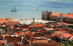 Bird view of central Lisbon. Bird way of central Lisbon with red roofs and river embankment Stock Photos