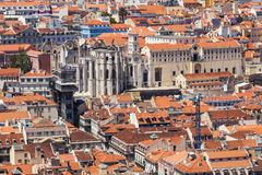 Bird view of Lisboa downtown. Santa Justa elevator and Carmo church ruins over Lisboa rooftops. Portugal Stock Photo