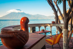 `Bird's Eye` View over Lake Atitlan in Guatemala. Picturesque view of Volcano San Pedro with a crown of clouds from a charming round terrace of a Stock Photography