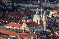Bird view of St. Nicolas church and Prague roofs Stock Images