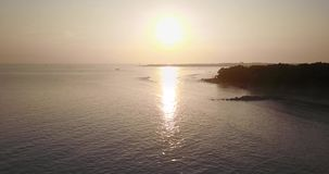 Bird view of sunset on the sea. Bird view footage of beautiful landscape with sunset reflection on the water at the sea, shot in 4k resolution stock video footage