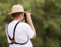 Bird Watcher. A man is watching something in his binoculars Royalty Free Stock Photography
