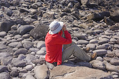 Bird Watcher Watching for Birds. On Espanola Island in the Galapagos Royalty Free Stock Photo