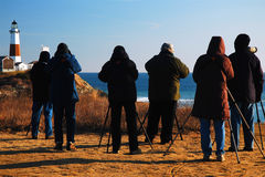 Bird Watchers at Montauk Point. Winter bird watchers brave the cold and wind to glimpse the feathered friends royalty free stock photo