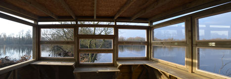 Bird watching hide looking out on to nature reserve. Stock Image