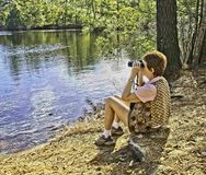 Bird Watching at Seashore State Park Virginia Beach, Virginia. As the first planned state park of Virginia, First Landing is listed on the National Register of Stock Photography