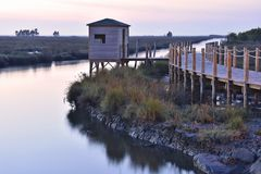 Bird watching wooden cabin and walkway Aveiro Portugal royalty free stock photos