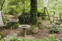 Birdbath near wooden swing Royalty Free Stock Photography