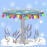 Birdbath in the snow Stock Image