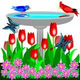 Birdbath und Tulpen Lizenzfreie Stockfotografie