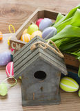 Birdcage with colorful easter eggs Stock Images