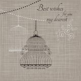 Birdcage on the fabric background Royalty Free Stock Images