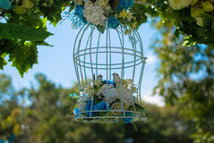 Birdcage. And flowers in the garden Stock Photos
