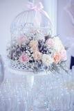 Birdcage with flowers Stock Photo